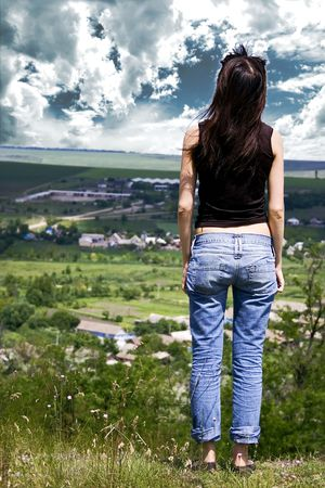 The girl on open spaces of steppe Stock Photo