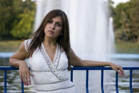 Beautiful brunet woman in da park Stock Photo