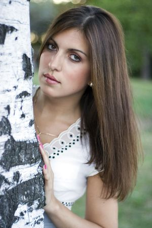 Beautiful brunet woman in da park Stock Photo