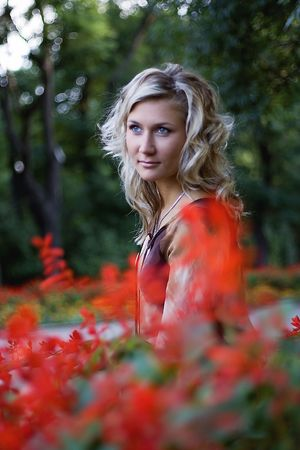 Blond at red flowers - 1 Stock Photo