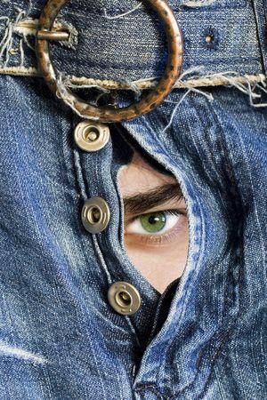 Steadfast sight through dark blue jeans