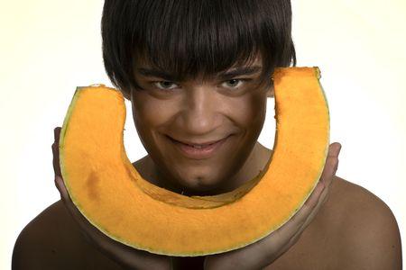 The man holds an orange pumpkin Stock Photo
