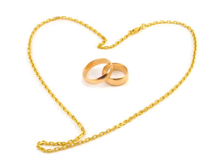 raytracing: Golden wedding rings with a chain composed of a heart on a white background Stock Photo