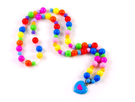 Plastic childrens multi-colored beads with blue heart isolated on white Stock Photo