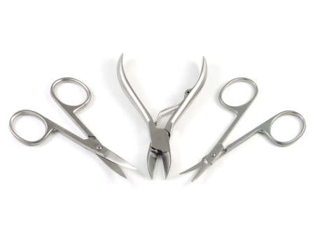 Manicure set isolated on a white three items, scissors, tweezers Stock Photo - 5913911