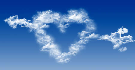 Heart and arrow out of the clouds on a background of blue sky.