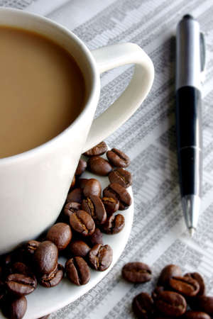 Business breakfast with coffee, paper and pen photo