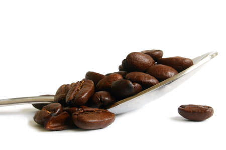 spoonful: Spoonful of roasted coffee beans