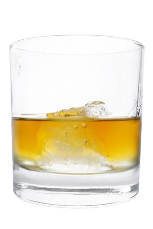tumbler: Isolated tumbler with whiskey and ice