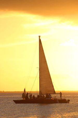 mujeres: Sailing ship at sunset off Isla Mujeres, Mexico