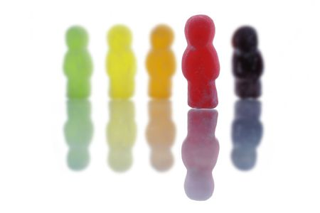 One jelly bean stands out from the crowd Stock Photo