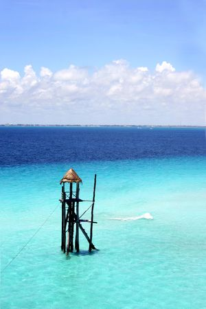 bl: Tower in the blue sea off Isla Mujeres, Yucatan, Mexico