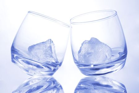 tilting: Ice in tilting glasses with blue hue