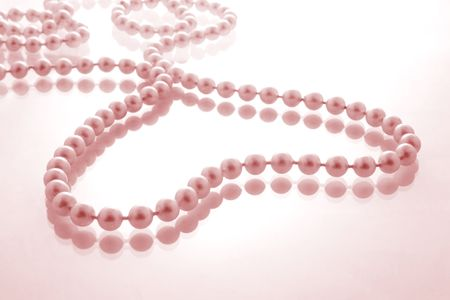 tinge: String of pearls in a heart shape ith pink tinge