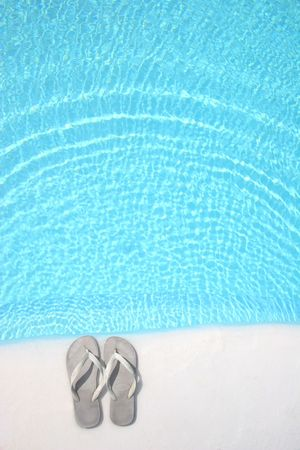 flip flops: Flip Flops on pool edge