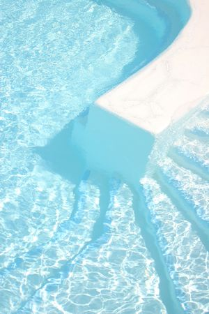 Bright blue swimming pool steps Stock Photo