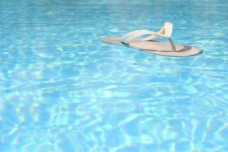 feat: White flip flop flotando en azul piscina