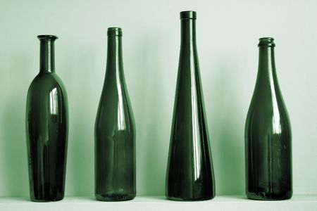 Green bottles against a wall