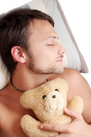 doze: Man asleep with teddy bear