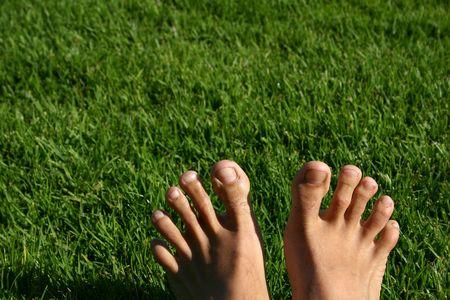 mans: Mans feet with green grass
