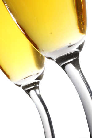 Champagne toast from low angle with curvy-stemmed glasses Stock Photo