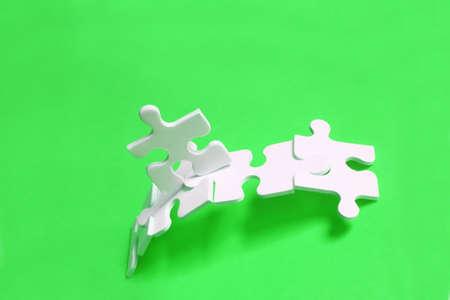 Jigsaw piece man crossing jigsaw bridge with bright background Stock Photo