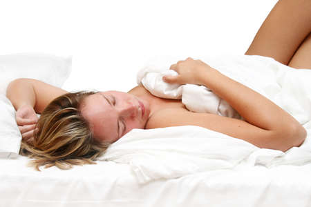 time sensitive: Woman asleep in bed with white linen