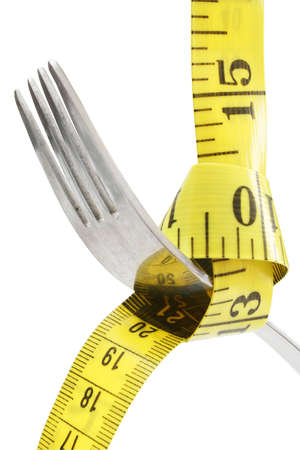 Fork hanging from measuring tape; includes CP photo