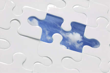 White jigsaw with piece missing and sky Background; CP for missing piece included Stock Photo - 381925