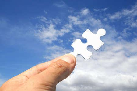 Jigsaw piece as key Stock Photo