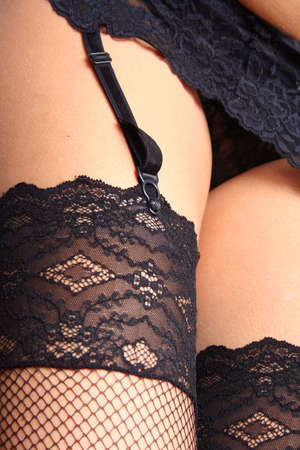seduction: Close upof woman in stockings and suspenders
