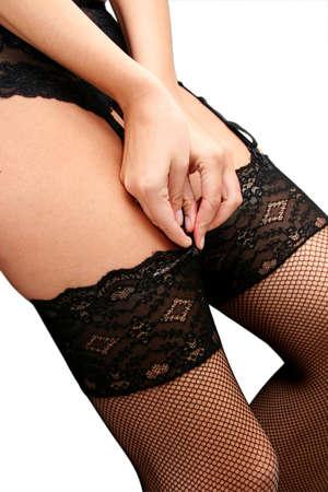 suspender: Woman in suspender belt and stockings