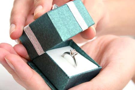 suprise: Woman opening ring box Stock Photo