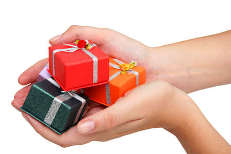 Female hands holding small gifts over white Stock Photo