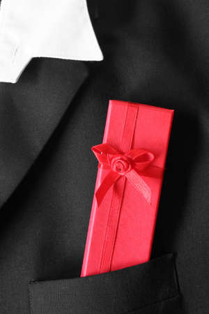 dinner jacket: Dinner jacket pocket with red gift box Stock Photo