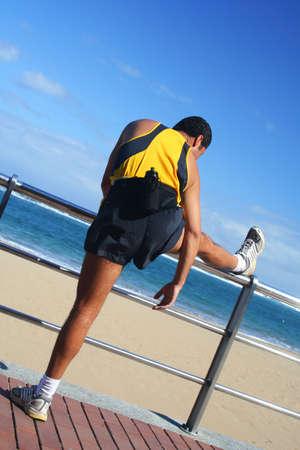Man stretching on the beachfront