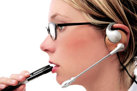Woman with telecoms headset and pen Stock Photo