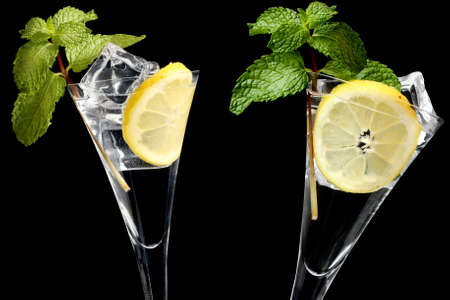 Mojito cocktails over black background photo