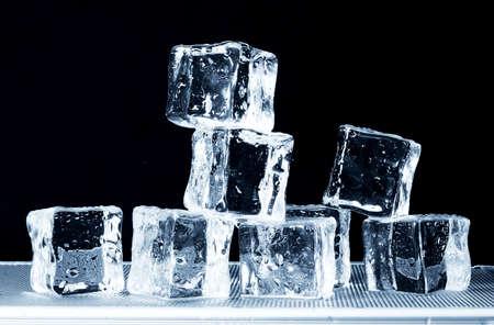 beverage fridge: Fresh ice cubes on freezer tray
