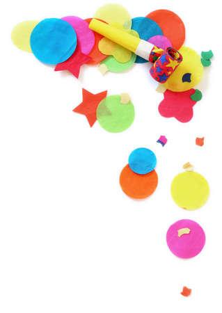 noisemaker: Confetti and noisemaker over white Stock Photo