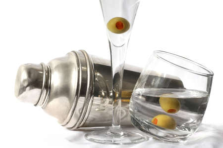 Cocktail shaker and martinis with olives