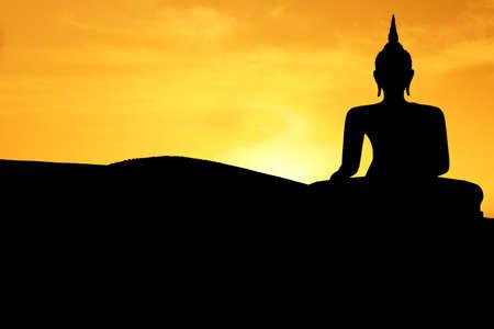 Thai style buddha at sunset Stock Photo