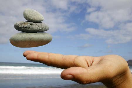 destress: Pebble and Hand Stock Photo