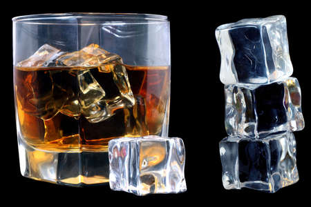 distilled: Whiskey in tumbler with ice cubes over black