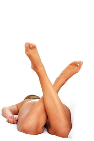 Woman in bed with her legs up Stock Photo - 566081