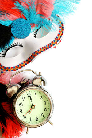 Carnival mask and alarm clock on white background with copy-space photo