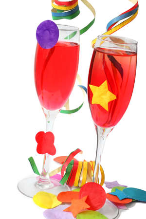 Red cocktail drinks in champagne flutes with streamers and confetti photo