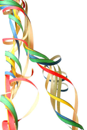 Colourful, curly party streamers over white