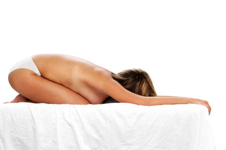 bakground: Woman on bed in yoga position with white bakground