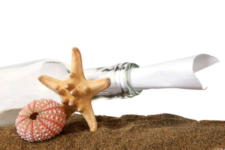 Message in a bottle with sand and sea creatures photo